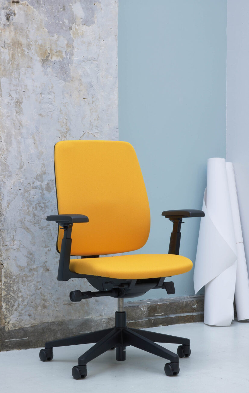 Comforto 29 task chair in yellow with upholstered back and adjustable armrests